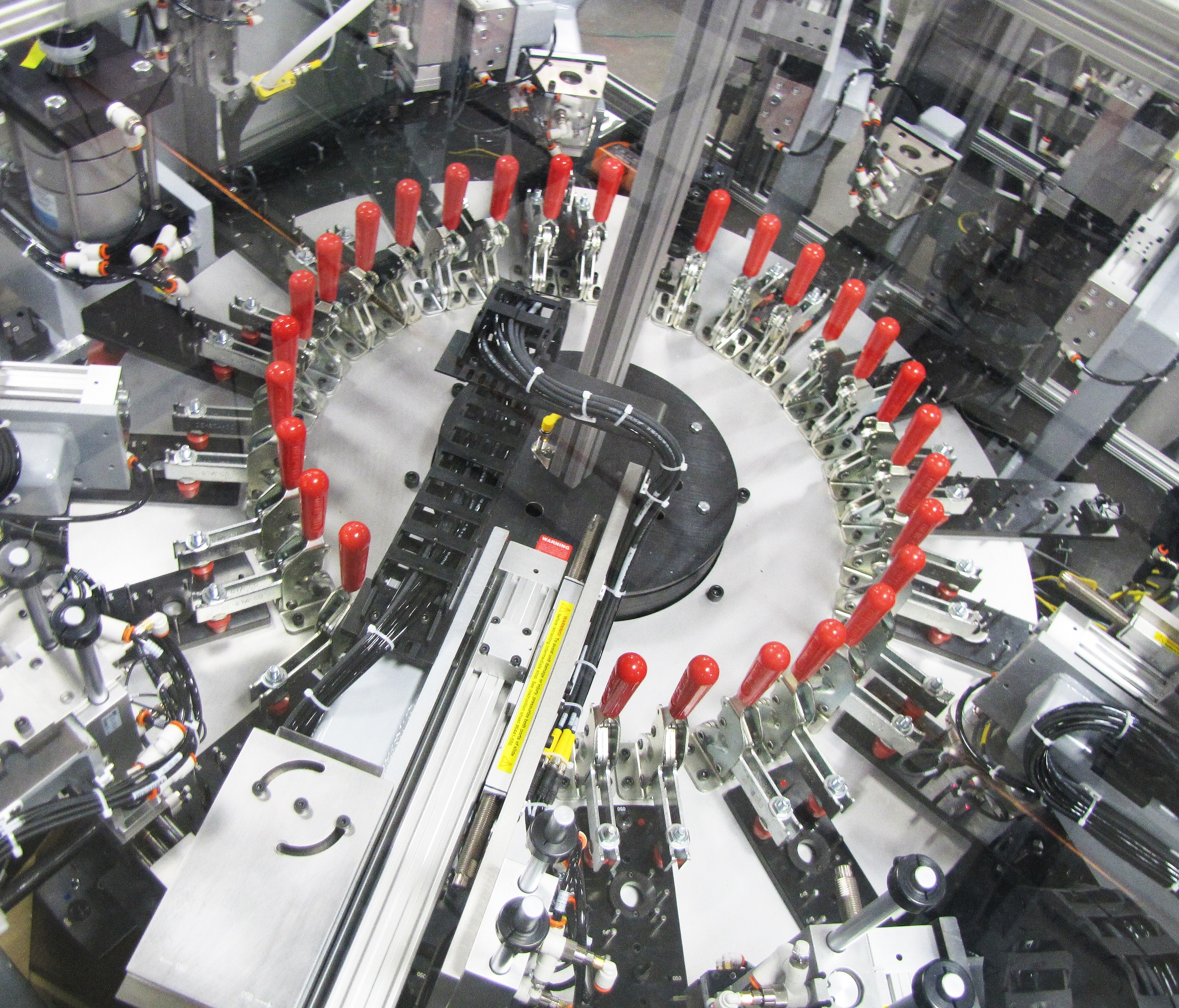 16-station dial assembly machine with vision inspection.