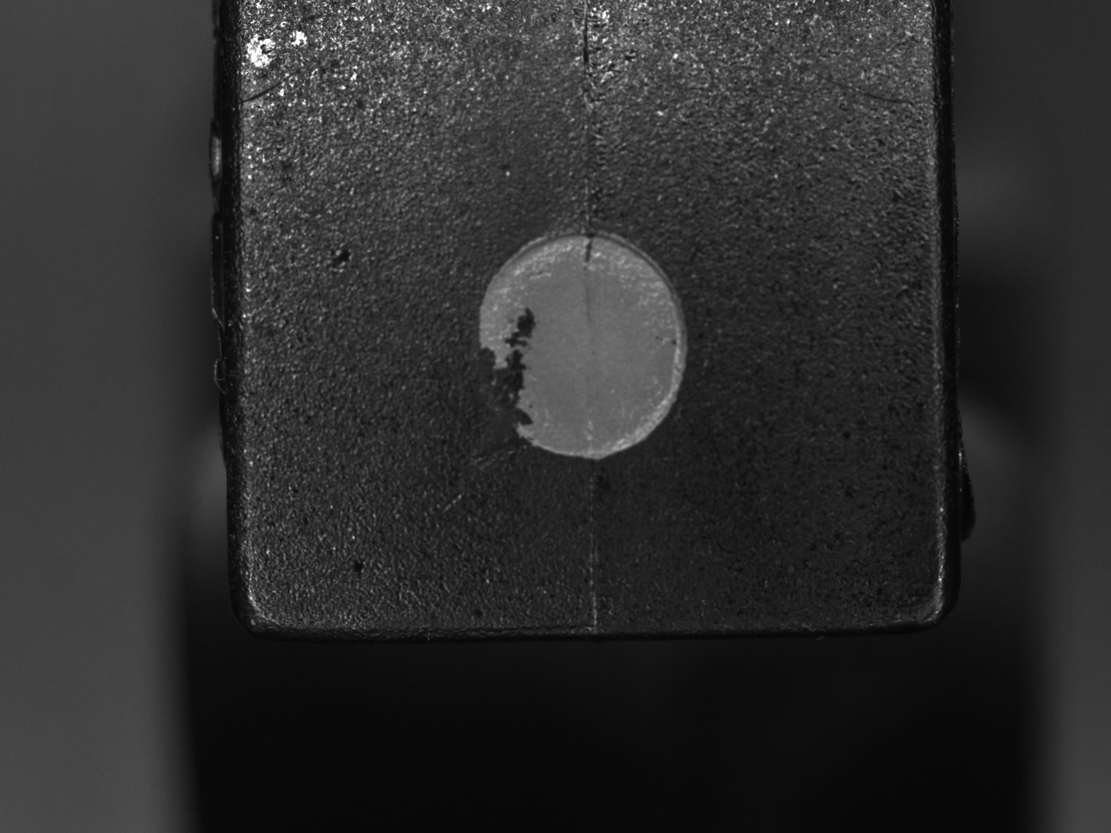 An incomplete good part marking – a passed part that the stamp station failed to completely mark.